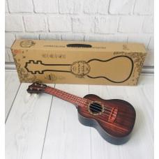 Детский игровой музыкальный инструмент Гитара 4-х струнная с медиатором и ремнем, 60 см, темно-коричневая