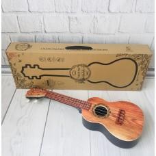 Детский игровой музыкальный инструмент Гитара 4-х струнная с медиатором и плечевым ремнем, 60 см, коричневая