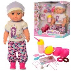 Кукла-малышка Функциональная Старшая сестричка в футболке, штанишках, шапочке: шарнирные колени, пьет, писает